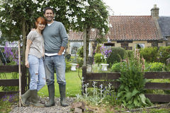 Couple Outside Country House Stock Photos