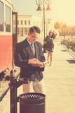 Couple outside retro train coach have a romantic encounter Stock Photo