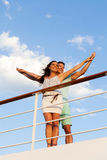 Couple outstretched cruise. Happy young couple with arms outstretched on cruise ship royalty free stock photo
