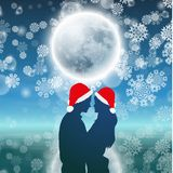 Couple over background with moon and snowflakes Royalty Free Stock Image