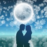Couple over background with moon and snowflakes Royalty Free Stock Photos