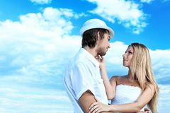 Couple over blue sky Stock Photography