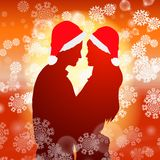 Couple over christmas background with snowflakes Royalty Free Stock Photos