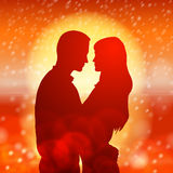 Couple over christmas background with snowflakes Royalty Free Stock Image