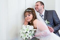 Couple overhear near closed doors Stock Photography