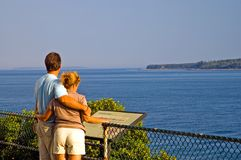 Couple overlooking ocean Royalty Free Stock Image