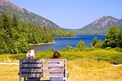 Couple overlooking scenic lake Royalty Free Stock Photos