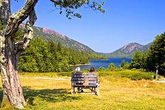 Couple overlooking scenic lake Stock Photo