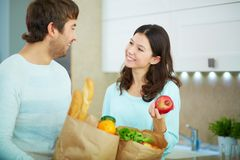 Couple with packets Royalty Free Stock Image
