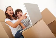 Couple packing Stock Images