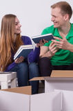 Couple packing books Royalty Free Stock Photography