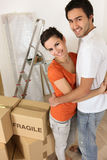 Couple with packing boxes Stock Photos