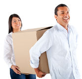Couple packing in boxes Stock Images