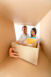 Couple packing in boxes Royalty Free Stock Photos