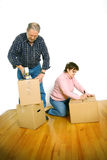 Couple packing boxes Royalty Free Stock Image