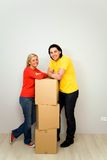Couple with packing boxes Stock Images