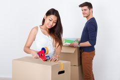 Couple packing cardboard boxes Royalty Free Stock Photo