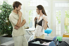 Couple packing for holiday Royalty Free Stock Image