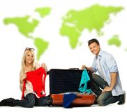 Couple packing suitcase for a journey Royalty Free Stock Image