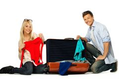 Couple packing suitcase Royalty Free Stock Photography