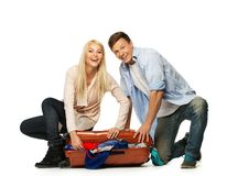 Couple packing suitcase Stock Photo