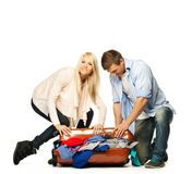 Couple packing suitcase Stock Photography