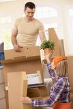 Couple packing to move. Young couple packing their property ready to move Stock Photography