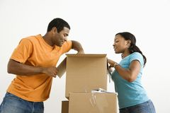 Couple packing together. Stock Photography