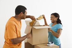 Couple packing together. Stock Photo