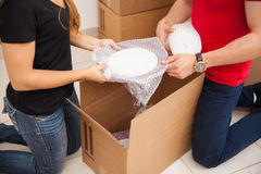 Couple packing together Royalty Free Stock Photos