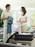 Couple packing for vacation Royalty Free Stock Images