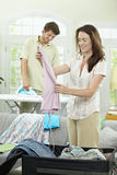Couple packing for vacation Stock Photos