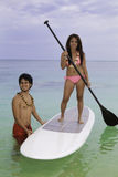 Couple with paddle board Stock Images