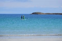 Free Couple Paddle Boarding On Blue Sea Royalty Free Stock Image - 152628226