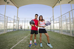 Couple in paddle tennis court Stock Images