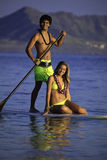 Couple on a paddleboard Royalty Free Stock Images