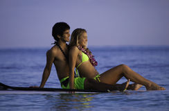 Couple on a paddleboard. Young couple on a paddleboard in a hawaii lagoon Royalty Free Stock Photo
