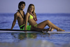 Couple on a paddleboard. Young couple on a paddleboard in a hawaii lagoon Royalty Free Stock Images