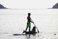 Couple on a paddleboard. Young couple on a paddleboard in a hawaii lagoon Stock Images