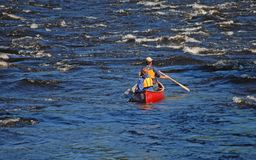 Couple paddling canoe on river Royalty Free Stock Photo