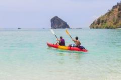 Couple paddling kayak in the andaman sea Stock Photo