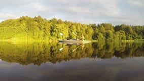Couple paddling kayak at sunset, majestic landscape, slow-mo. Stock footage stock video