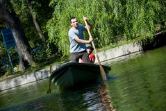 Couple paddling in rowboat Royalty Free Stock Images