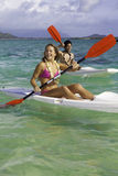 Couple paddling surfskis Royalty Free Stock Images