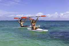 Couple paddling surfskis Royalty Free Stock Photos