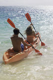 Couple paddling their kayak Royalty Free Stock Photography