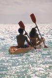 Couple paddling their kayak Stock Photography