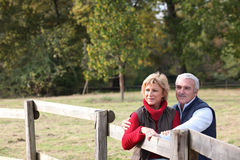 Couple by a paddock Royalty Free Stock Photography