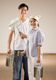 Couple with paint brush and paint can Royalty Free Stock Photos