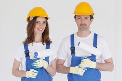Couple with paint rollers Royalty Free Stock Photo